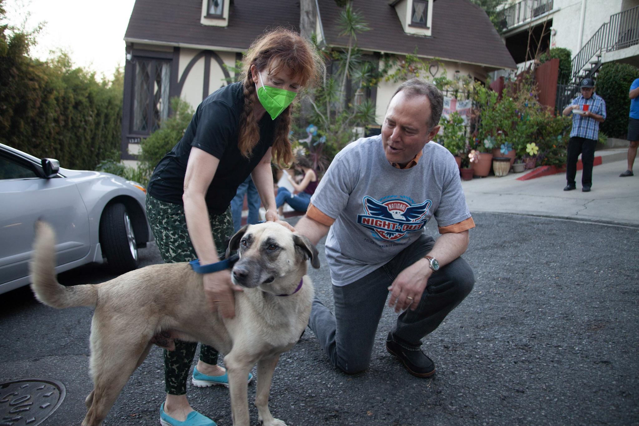 Adam Schiff petting a dog